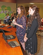 Alayna Pohler (left) and Josie Eckert, members of the Riverview Middle School Seventh Grade Blue Team, explain to the Huntington County Community School Corporation Board of School Trustees at its April 10 meeting how they decided to create a lip balm product for their Genius Hour project. The profits from sales of the lip balm are being donated to The Salvation Army.