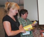 Teresa Kaylor (left) and Kellie Herber check expiration dates of recently donated non-perishable food items on Monday, June 21, in the kitchen of the Malta House, a men's shelter that is planning to open this September.