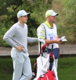 Former Huntington resident Tom Maples (right) stands with professional golfer Patrick Rodgers at a Web.com Tour event in Columbus, OH, in 2014. Maples is Rodgers' caddy and travels to golf tournaments across the country and beyond on the Web.com and PGA tours.