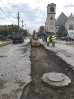 A crew from E&B Paving scrapes up remnants of the old interurban track from the middle of Market Street, in Huntington.