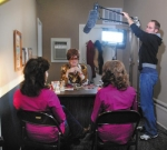 Audio specialist Matt Boylan (standing) adjusts the microphones over actresses (from left) Robyn Scott, Kate James and Colleen Murray in a former office space in downtown Markle on Saturday, Nov. 20.