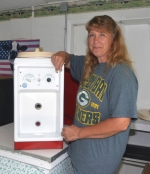 Taking advantage of the calm before the storm on Thursday, July 20, Kathy Blinn readies a milk shake machine to churn out hundreds of cold and creamy treats for visitors to the Huntington County 4-H Fair.