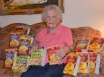 Charlotte Mitchell displays some of the grocery items she purchased last week for The Shepherd's Pantry in Andrews. The Andrews resident makes multiple shopping trips each week as she searches out bargains to help fill the food pantry's shelves.