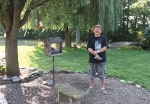 Robert Meier stand next to his hummingbird feeders outside his home, where his land has been deemed a Certified Wildlife Habitat by the National Wildlife Federation.