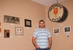 Rev. Bobby Kemp, the lead pastor of Huntington First Church of the Nazarene, stands in the church's new Legacy Room, which tells the story of the church's history through pictures, mementos and artifacts. The room was put together in honor of the church's 100th anniversary, which was celebrated on May 19.