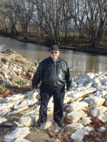 Richard Ness stands on the stone bridge of Silver Creek, which sits on his family's property along the Wabash River. Ness works year round to preserve the historic area and prevent flooding and erosion.