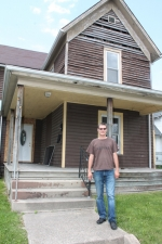 Rev. Jimi Staton, pastor of New Life Fellowship, stands in front of the house the church purchased for $50 that will become the Women and Children's Life House residence, once renovations are complete. The ministry is expected to be open to residents in October.