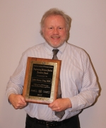 John Nixon, of Huntington County, stands with the Founders Award, an accolade given out by the American Academy of Forensic Sciences that recognizes outstanding service to the engineering sciences. Originally from Scotland, Nixon has made a name for himself in the United States as a forensic consultant and expert on weapons systems and explosives.