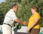 Matt Roth (left) representing the Huntington Rotary Club, congratulates 2009 Outstanding 4-H Leader Nadean Brown during an awards ceremony on Saturday, July 25.