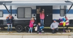The Make-A-Wish Foundation presented 12-year-old Sadie Lentz (center, seated) and her family with a camper. The foundation orchestrated a drive-by celebration for the Lentz family that took place on Saturday, Jan. 16. Featured (from left) are mother, Sheila Lentz; 9-year-old sister, Rylie Lentz; 12-year-old sister Alexis Lentz, and father, Steven Lentz.