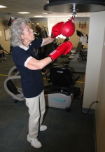Mary Jane Craig, of Warren, works on a boxing speed bag in the Heritage Pointe fitness room during the retirement community's Rock Steady boxing class on Thursday, March 12. The biweekly class is for people with Parkinson's disease and seeks to diminish its effects with boxing workouts.