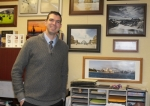 Michael Parsons, assistant principal at Riverview Elementary School, stands in his office beside pictures he and his wife, Arlene, have taken during their trips around the world. Parsons was recently awarded a $12,000 grant from the Lilly Foundation, in Indianapolis, to travel out west, where he'll photograph locales such as Yellowstone National Park and subsequently make unique inspirational posters that will be hung up around Riverview.