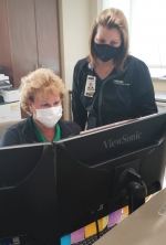 Amy Rosen (left), clinical program director, Parkview Huntington Center for Wound Healing, and Kim O'Banion, front office coordinator, focus on scheduling appointments far enough apart to ensure patient safety.