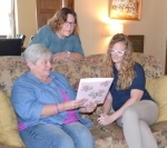 Sharon Metzger (right) listens as Sue Williams (left) and Paula Blackstone (center) go over plans for a support group open to adults with loved ones suffering from addictions. Metzger is executive director of Place of Grace, where both Williams' and Blackstone's daughters found help in recovering from their addictions, but the support group is independent of the transition center.
