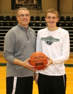 Ty Platt (left), head coach of the Huntington University men's basketball team, stands with his son, Kyle, who is a freshman on the team. Though this is their first year together at HU, the elder Platt has coached his son for years.