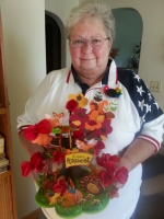 Pam Worrel, poppy chair for the American Legion Post 160 Ladies' Auxiliary, displays the Thanksgiving centerpiece she made to showcase the red Buddy Poppies made by area veterans.