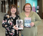 "Huntington City-Township Public Library employees hold up the two most popular books checked out in 2017.  Circulation Supervisor Kay Stine (left) holds a copy of ""Two by Two"" by Nicholas Sparks, which was the most checked-out adult fiction book, while Library Assistant-Acquisitions Deb Roy holds ""Cross the Line"" by James Patterson, the most popular adult large-print book. The Huntington and Markle library branches are already on track to break 200,000 in circulation for this year."