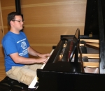 Preston Shafer plays a piano piece from memory in the recital hall at Huntington University. Shafer, a 2012 graduate of Huntington North High School, is majoring in music education at the university, where he also teaches private voice and piano lessons.