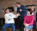 Improv class students (from left to right) Tank Lowe, of Bluffton; Darren Turney, of Fort Wayne; and Lily Sabinske, of Warren, play out a skit by interacting with each other off the cuff on Saturday, Feb. 28. The six-week workshop is being held at the Pulse Opera House in downtown Warren.