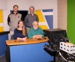 RTV, the daily, student-produced television news show at Riverview Middle School, in Huntington, is celebrating its 25th anniversary this school year. The show was started by David Dean Sr. (seated right), a former English teacher at the school. With Dean in the RTV studio are (seated left) the very first RTV anchor, Rochelle Kiefer Kennedy, who is now a Riverview teacher, and (standing from left) Chris Husband and Steve Park, teachers who succeeded Dean in leading RTV.
