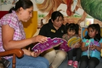 """Rosa Sprowl (left), of Majenica, reads """"La Cenicienta"""" (""""Cinderella"""") in Spanish to children on Monday, July 7, at the Warren Public Library."""