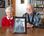 Maxine and Max Richardson pose with a photo of Max as a dark-haired teen atop the bicycle that brought them together. The rural Huntington couple celebrated their 70th wedding anniversary on March 3.