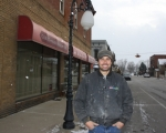 Deco Illusions Owner and Roanoke Beautification Foundation Board Member Rick Fischer shows off one of the historic streetlamps strung with lights for the holidays. The streetlamps along First Street are one of the recent projects that the Roanoke Beautification Foundation has completed.