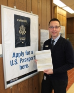 Scot Riggers, lead sales and service associate at the United States Postal Service Huntington branch, holds an application for a U.S. passport inside the post office on Tuesday, Jan. 23. Riggers says although the process to apply for a passport is relatively easy, the time is growing short to get a passport in time for spring break travel.