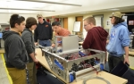 Team THRUST Coordinator Chris Elston (center) coaches his team on how to make its robot fire cannonballs at the Vocational Technical Center on Monday, Feb. 8. Team members pictured are (from left) Jake Garlits, Jacob Burns, Doug Melchi, Andrew Land and Noah Nguyen.