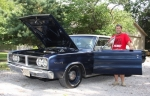 Terry Martin, of Roanoke, stands alongside his 1966 Dodge Coronet 500. The car, which has a 426 Hemi engine and an automatic transmission, is one of only 132 manufactured with those specifications. Martin discovered the rare car sitting in an abandoned barn in rural Huntington County. It will be on display at this year's Rolling into Roanoke car show, which takes place Saturday, July 23, from 10 a.m. to 4 p.m.