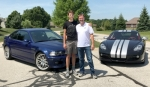 Roanoke native Klint Crawford (right) stands beside his 2012 Porsche Cayman R while his son, Clay, stands beside his 2005 BMW M3. The Crawfords will be bringing their cars to Roanoke on Saturday, July 21, for this year's Rolling into Roanoke car show, where the spotlight will be on European automobiles and motorcycles.