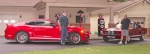 Steve Federspiel (left), of Roanoke, stands beside his 2016 Shelby Mustang GT350 while Blake Caley, of Markle, stands beside his 1967 Shelby Mustang GT350. Tony Cotterman, of Fort Wayne, won the cars in a national contest in March, but was unable to drive them due to a physical disability. Federspiel and Caley stepped up and purchased the cars from Cotterman for more money than the contest's cash prize alternative. Both vehicles and all three men will be at this year's Rolling into Roanoke car show on Saturday, July 22. Photo by Steve Clark.