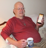 Ed Robbins, of rural Huntington, shows a list on his cell phone of the multiple calls he's recently received from scammers. A variety of scams that especially target the elderly have not only inundated his phone, but his wife and numerous other local Seniors have also gotten calls. Photo by Rebecca Sandlin.