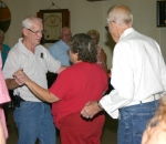 Butch Tracey, of the Happy Feet Round Dance Club, helps teach the moves during a recent round dancing lesson in the Moose Lodge. Tracey says his club will offer lessons in Huntington again, possibly in the winter.