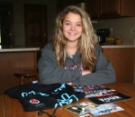 Rylie Lynn Bowman, 17, displays some of the memorabilia she collected during her recent travels with the Teen Nation Tour. Bowman sang and shared her experiences with students during the anti-bullying tour's stops at middle and high schools.