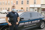 tanding in downtown Huntington with his police car is school resource officer Ben Whitman. Whitman graduated from Huntington North High School in 2009 and is now a school resource officer there.