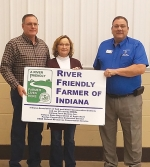 The 2020 River Friendly Farmer Award was awarded to (from left) Joe and Elaine Carroll by Huntington County Soil and Water Conservation District Supervisor Kyle Lund during the SWCD's annual meeting and banquet on Tuesday, Feb. 23.