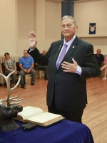Donald Schoeff Sr. takes the oath of office to become Grand Tiler for the Benevolent and Protective Order of Elks.