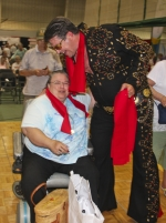 Elvis tribute artist Gordy Clemens gives a scarf and a hug to Gail Green during the 2014 Huntington County Senior Expo. The expo returns this year on Thursday, May 21, and Clemens will once again bring his act to the expo stage.