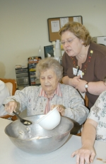 Hope Worster mixes up pumpkin dog biscuits as Tina Tiernon looks over her shoulder.