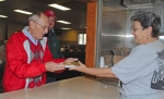 Dave Heiney, left, accepts a plate of free food from Lynn Clabaugh during a veterans' lunch at the Roanoke American Legion Post 160 on Saturday, Nov. 6. Looking on is Heiney's brother Dennis, a veteran visiting from Ohio.