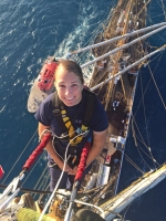 Boatswain's Mate Shelbie Smart stands at the top of the 147-foot-tall mast of the Coast Guard cutter Eagle, the deck of the ship and the ocean visible far beneath her. Smart just completed a three-year stint on board the tall ship, which started life as a Nazi training ship. It now serves the same purpose for the United States Coast Guard.
