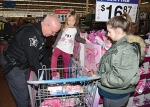 Huntington County Sheriff's Deputy Matt Weicht (left) helps London Haddock try on a pair of sneakers during the 2019 Shop With A Cop on Tuesday, Dec. 17. This year, Shop With A Cop will look a little different, but will still assist those in need. Shop With A Cop is scheduled for Tuesday, Dec. 15, this year.