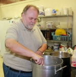 Scott Thorn, director of the New Life Community Meal Ministry, stirs a pot of soup he made for the evening's free community meal on Wednesday, Aug. 12. A recent donation paid off the mortgage on the ministry's building. Between 45 and 50 people take advantage of the free dinner nightly.