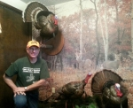 National Wild Turkey Federation (NWTF) Indiana State Board Member and Flint Springs Chapter President Steve Nevius shows off three of his various turkey hunting trophies at his home on Nov. 22.