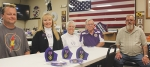 Sitting with a few of the Purple Heart masks, created by Two Mothers of Two Purple Heart Sons, which are available at the VFW Post 2689 for Purple Heart recipients are (from left) Wade Perkins, Karen Wehr, Gloria Holzinger, Larry Shaw and Chuck Kuschel.