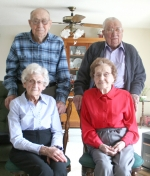Roanoke residents Ted (back left) and Claribel Husband (seated, left) and Art and Mary Burton have been married for a combined 147 years. The couples say the key to their success is a strong commitment to each other.