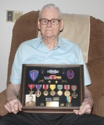 Ed Merckx, of Huntington, shows the medals he received as a result of his performance in World War II at his home on Tuesday, May 25. Merckx fought in the D-Day operation and in Belgium.
