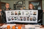 Emily Goedesky (left) and her sister, Rachel Zahm, both of Huntington, hold up a banner with the photos of the 17 Huntington County men killed in the Vietnam War, including their father. The sisters have been trying to reach family members of the men to invite them to the unveiling and dedication of a memorial to the Vietnam veterans during ceremonies to be held Nov. 11 at Memorial Park.