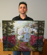 Warren resident Bruce Winters holds one of the paintings he has created. Winters' work is currently being shown in the Balentine Gallery in Bluffton through Friday.